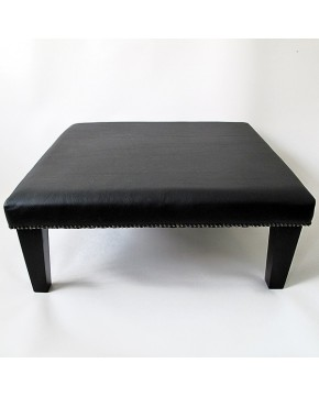 Plain black grained leather footstool 114 with modern tapered black leg