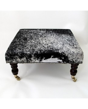 Dappled black square cowhide footstool 210 size medium with dark turned leg and castors