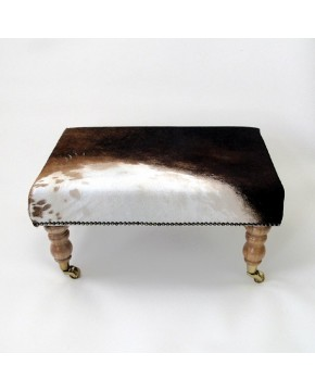 Multi coloured small rectangular cowhide footstool 208 with light turned legs
